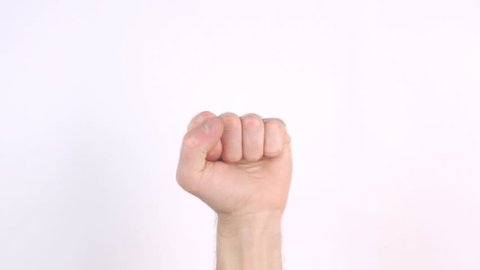 Angry Caucasian Man Holding His Fist Up In The Air