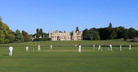 WALDEN, ENGLAND - 11 SEP 2018: Cricket match historic manor house England. 17th century country house. Historical tourist destination for classical beautiful architecture. Sport and recreation.