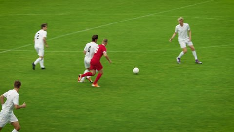 Professional Soccer Players Playing Pass Trying to Score a Goal. Impressive Professional Match on International Championship. Panoramic Slow Motion Shot.