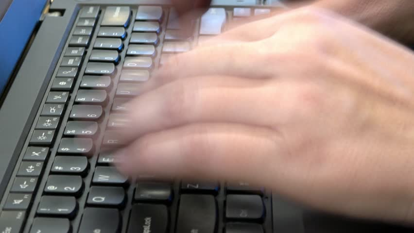 Fingers flying over a laptop keyboard slow shutter to convey speed | Shutterstock HD Video #1019554840