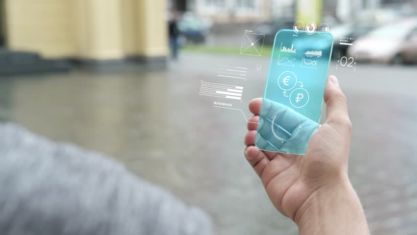 Future technology. Futuristic hologram of business and Finance. Exchange rate. The businessman uses the technology of the future on his smartphone. | Shutterstock HD Video #1019581600