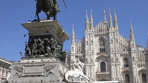 The Milan Cathedral (Duomo di Milano) and monument to Victor Emanuel II in the Piazza del Duomo in Milan, Italy, slider dolly shot 4k