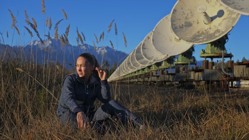 Woman student operator of institute of Solar Terrestrial Physics resting after work. Unique array solar radio telescope. Sun Solar Radio Telescope. The 'Quasar' observatory in Badary, Russia | Shutterstock HD Video #1019631400