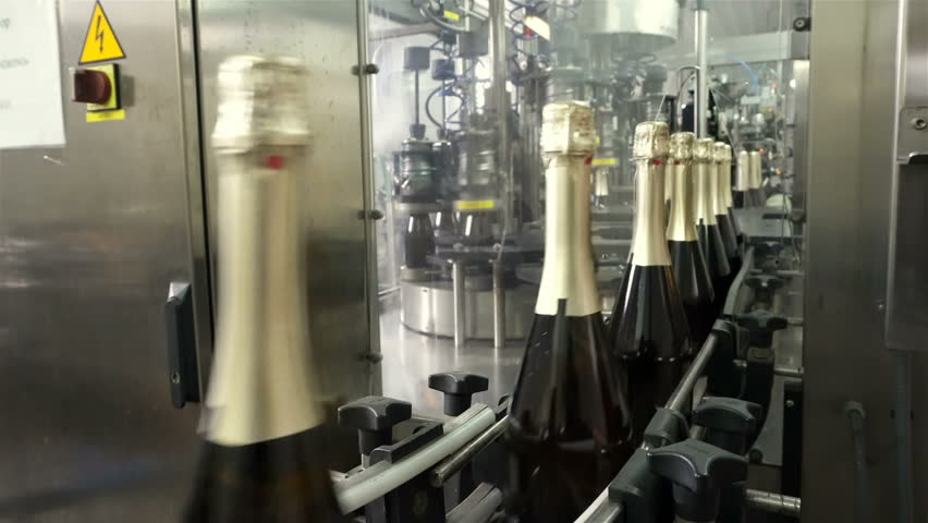 Sennoy, Russian Federation – February 15, 2018: The line for filling and sealing the conveyor in a factory of champagne | Shutterstock HD Video #1019652520