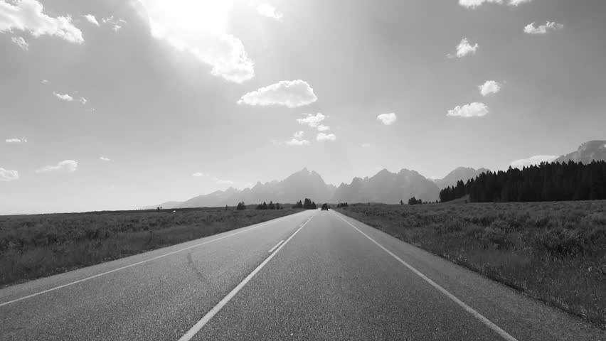Driving a Car towards Grand Teton, back light, Point of View - Mounted 2.7k Ultra HD footage   Shutterstock HD Video #1019706730
