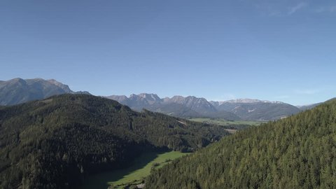 Farm field crops aerials in Austria 4k source Green grass and Dead cerops
