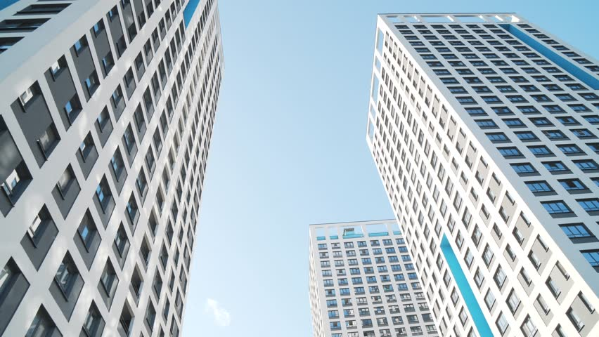 Angle view of white skyscrapers against blue sky. Frame. Fantastic below view | Shutterstock HD Video #1019759200