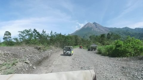 YOGYAKARTA INDONESIA, NOVEMBER 22 2018 : Adventure Lava Tour Merapi with Jeep of Merapi Lava Tour in the morning vie merapi mountain