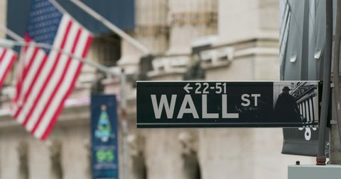 NEW YORK CITY, NEW YORK - NOVEMBER 20 2018: Panning shot of the Wallstreet sign right on the corner of the New York Stock Exchange, also known as the NYSE.