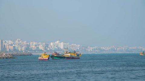 vishakapatnam,andhrapradesh /india -november 18th 2018 :Boats in sea city background  view fishing video beach port area market closeup in 4k