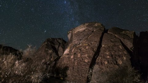 Motion controlled astrophotography time lapse with dolly tracking & zoom in motion of Milky Way galaxy over ancient Native American petroglyphs in Eastern Sierra, California