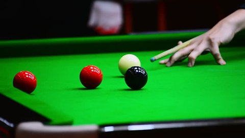 Close up of Snooker shooting on snooker table. Game of snooker.