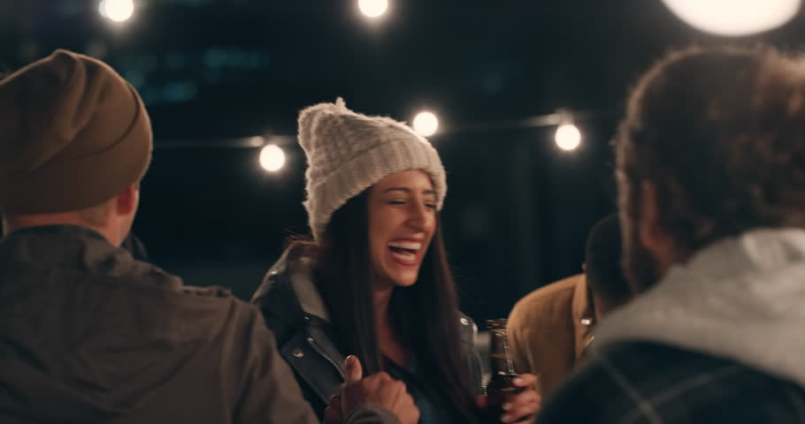 Young group of multiracial friends having fun dancing playfully together enjoying rooftop party at night laughing celebrating friendship new years eve cinematic 4k footage event shot on Red Epic