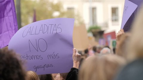Poster with inscription in spanish. Shut up we are not prettier. Feminist Activists in a Demonstration. March for the International Day of Nonviolence against Women and Children in Barcelona, Spain