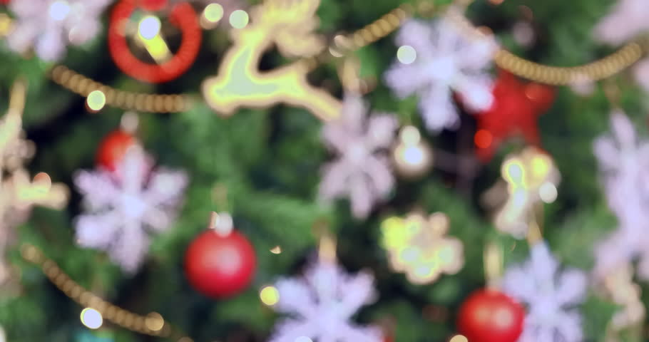 Close up scene VDO of blurred beautiful Christmas tree, then it turn to be clear, it decoerated by gorgeous ornament and ornamental light, concept for or Christmas celebration.  | Shutterstock HD Video #1020435820