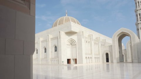 Beautiful view of the Sultan Qaboos Grand Mosque from arched passageway in Muscat, Oman. Amazing Islamic architecture.