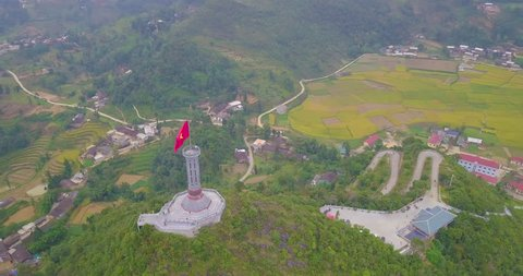 Lung Cu flag tower. Royalty high-quality stock video footage of Lung Cu flagpole in Ha Giang province, Vietnam. The national flag Vietnam on the tower the North Pole of Vietnam and border with China