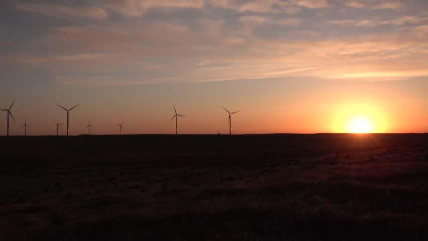 Scenic view of wind turbines power generator, Wind turbines at sunset in the state of Idaho, USA #1020616840