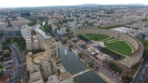 Aerial drone zoom out over Antigone neighbourhood in Montpellier. Semi-circular building architecture France