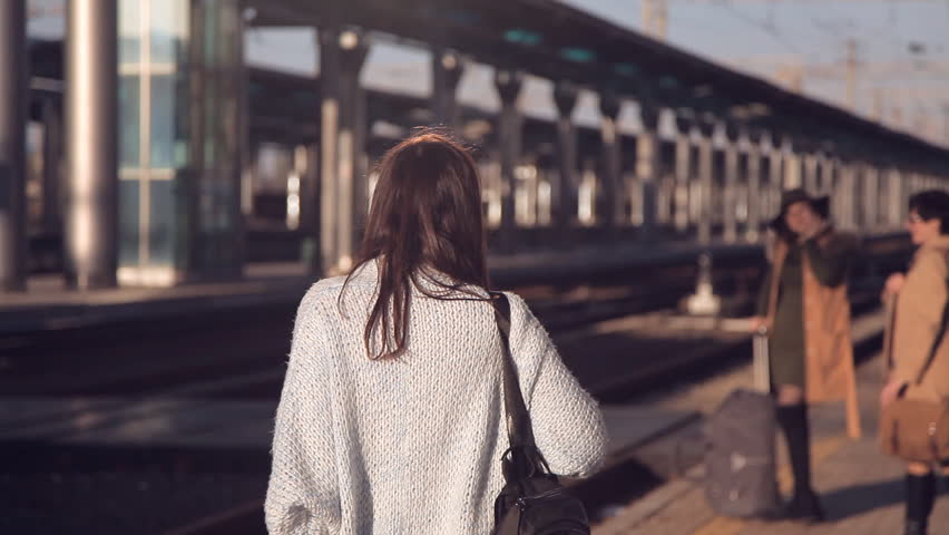Passengers with suitcases walking on the platform of the railway station. Three women with suitcases walking on the platform of the railway station | Shutterstock HD Video #1020649390
