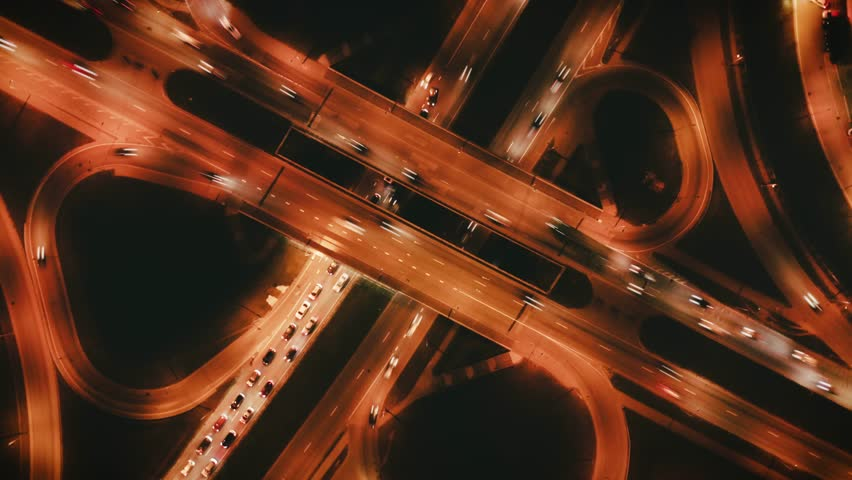Highway cloverleaf interchange intersection (junction) with ramps, heavy traffic, aerial hyperlapse. A cloverleaf typical  two-level, four-way interchange. | Shutterstock HD Video #1020651280