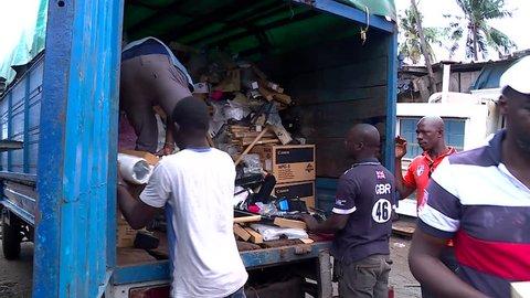 Abidjan, Cote d'Ivoire - 09 19 2016: ABIDJAN, IVORY COAST, September 2016. Electronic waste dangerously recycled in Abidjan, Africa.