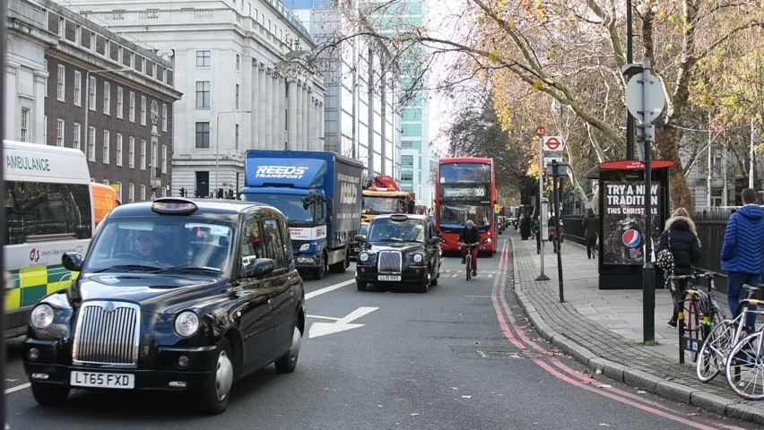 London 12 01 2018 Traffic in London is full of red bus and taxis Black cab