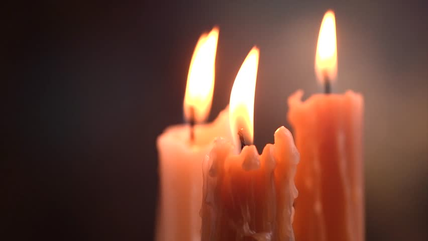 Candles flame close up on a dark background. Candle light border design. Melted Wax Candle Burning at Night. White Candles Burning in the Dark. Candlelight. Slow motion 4K UHD video | Shutterstock HD Video #1020791290