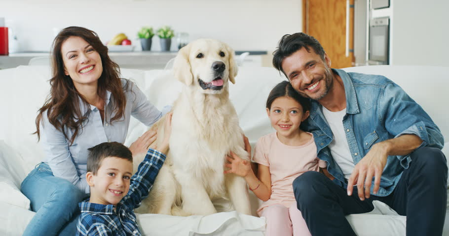 Portrait of happy family with a dog having fun together in living room in slow motion. Shot with RED camera in 8K. Concept of happy family, | Shutterstock HD Video #1020812620