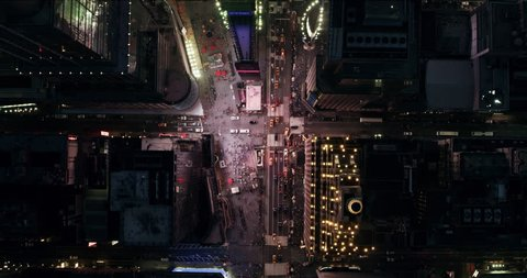 Top down aerial view of busy streets and summer nightlife in Times Square, New York City. Shot on 4k RED camera