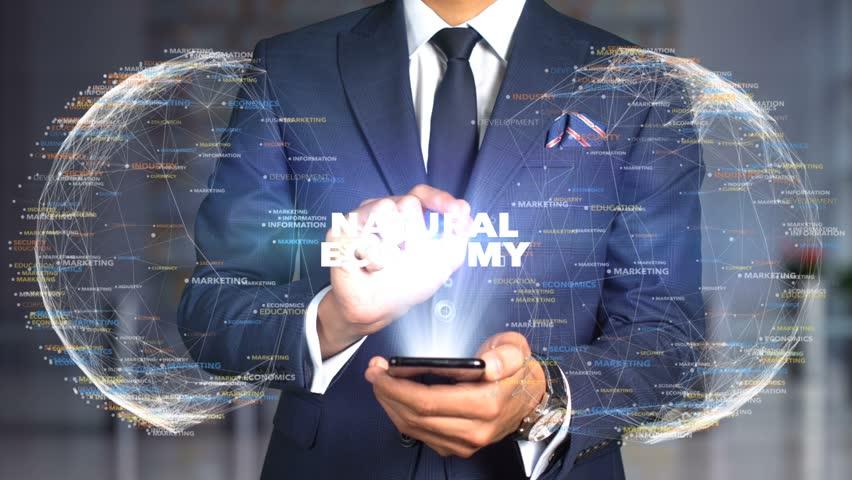 Businessman Hologram Concept Economics - Natural economy | Shutterstock HD Video #1020895450