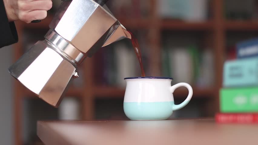 Pouring Coffee from a Mocha Pot - Lovely Blue Mug With Steam  | Shutterstock HD Video #1020920740