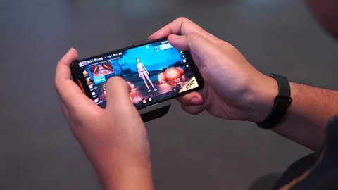 Jakarta, Indonesia - December 13, 2018: The ASUS ROG Phone playing a Free Fire. It mobile game where players enter a battlefield where there is only one winner - the last man standing.
