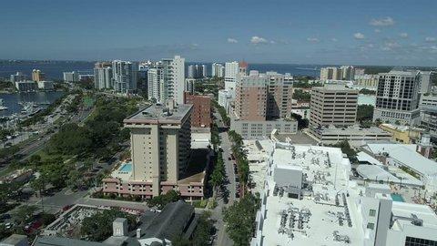 Sarasota, Florida / United States - 10 10 2018: Sarasota, FL, October 2018 – Drone reveals a peaceful Sarasota Bay view from downtown Sarasota.