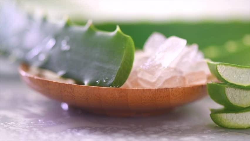 Aloe Vera gel closeup. Sliced Aloevera plant leaf, natural organic renewal cosmetics, alternative medicine. Skin care concept. Dolly shot, On white background. 4K UHD video   Shutterstock HD Video #1020974860