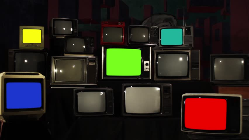"Vintage Tvs with Multiple Color Screens Turning On. Aesthetics of the 80s. Ready to Replace Each Color Screens with any Footage or Picture you Want. You can do it with ""Keying"" Effect. 