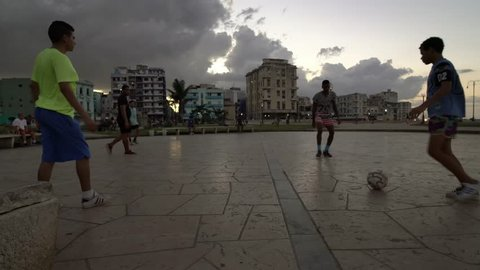 HAVANA, CUBA - Oct 18, 2018:  Kids are playing football (soccer) in neighborhood park square in Havana, Cuba. La Habana Vieja / Havana is an iconic popular tourist destination for travel.