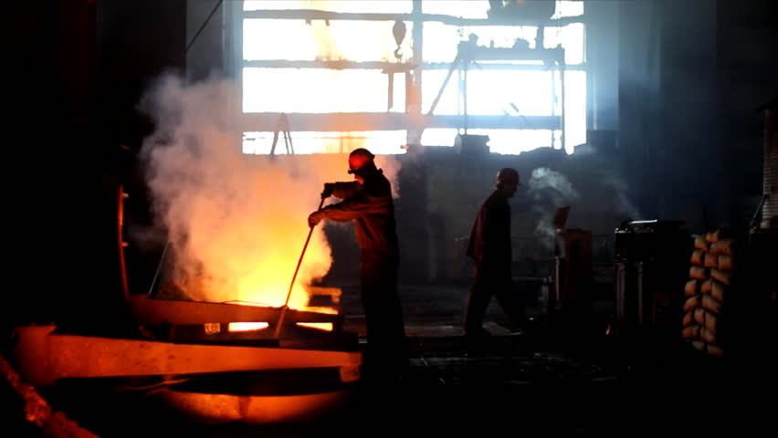 Putting iron in the furnace to melt