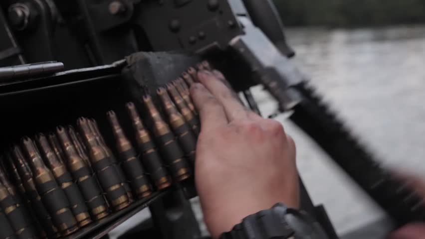 West Virginia, The United States of America - November 16, 2018: Amazing shot of a machine gun fired by a US soldier from a boat #1021061080