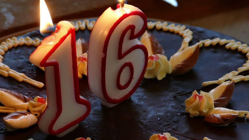 Sixteenth Birthday cake with burning numerical candles