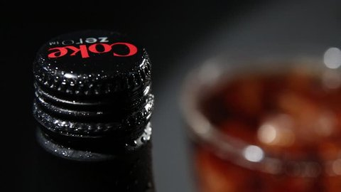 Prague, Czech Republic - December 16 2018: Bottle of Coca Cola Zero with Water drops and Glass with the Ice Cubes