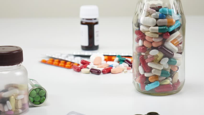 Tablets and pills. Pharmacy. Close up. Zoom in | Shutterstock HD Video #1021129090