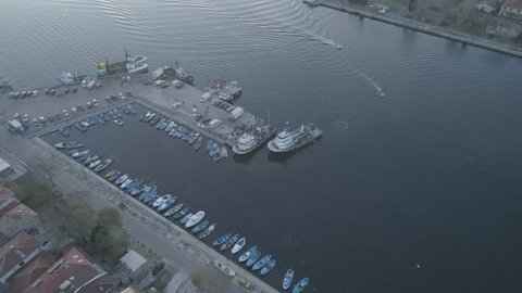 Sozopol/Bulgaria- november 24,2018:Drone view on boats and yachts at the pier in the seaport of Sozopol, Bulgaria,at sunset