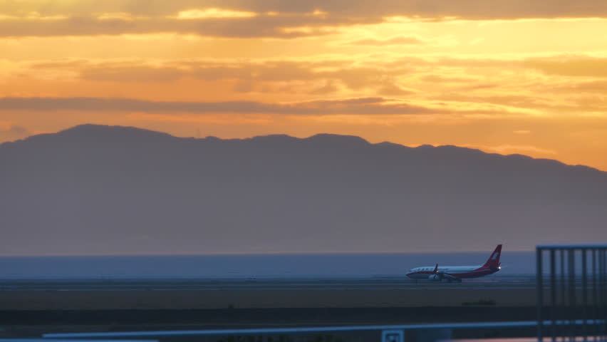 SUNSET AND AIRLINER at KIX KANSAI INTERNATIONAL AIRPORT JAPAN - May 11, 2017 | Shutterstock HD Video #1021377400