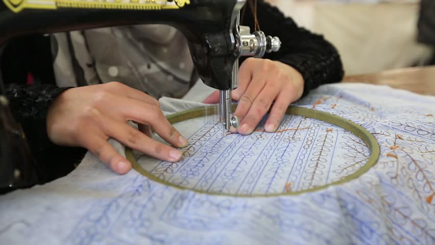 Arab woman embroidering a dress In a sewing workshop. | Shutterstock HD Video #1021538260