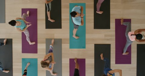 top view yoga class of young healthy people practicing triangle pose stretching enjoying fitness lifestyle exercising in studio