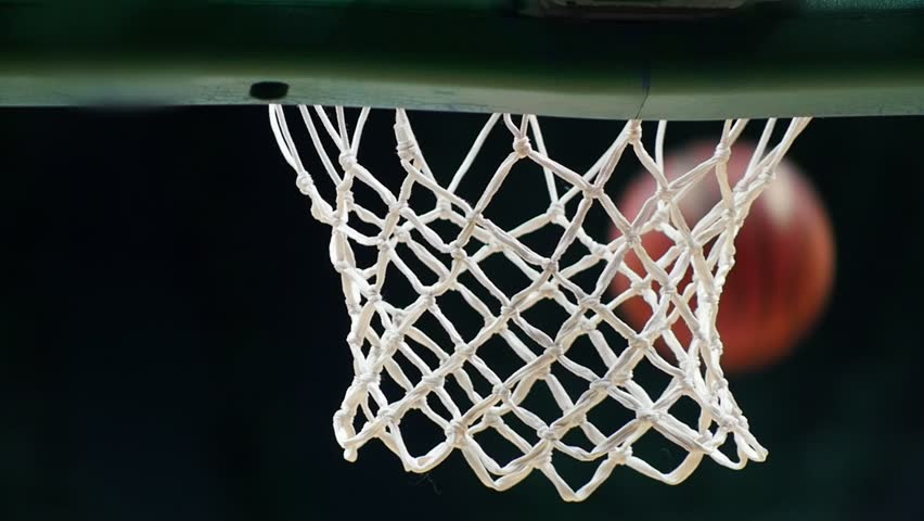 A basketball tournament. Throwing a ball in a basketball hoop. The ball gets right in target. Slow motion | Shutterstock HD Video #1021566370