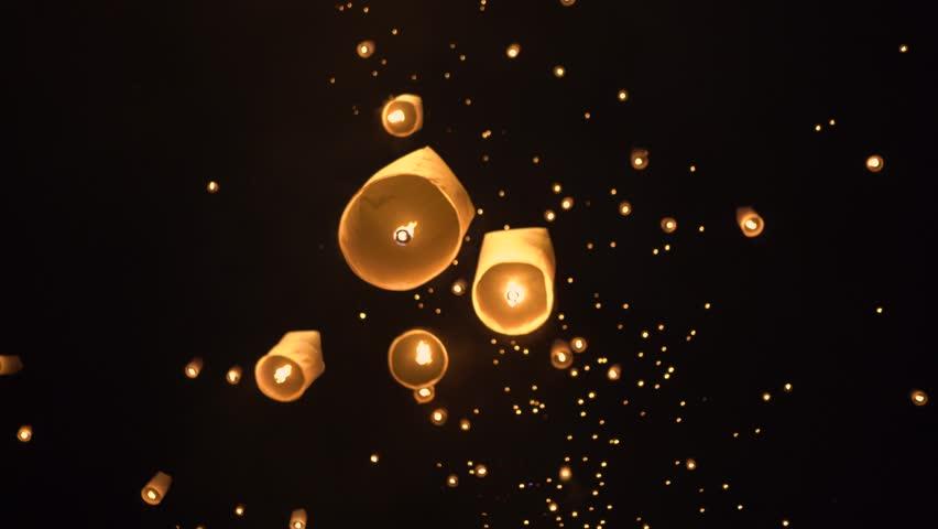 Floating lanterns in the night sky. Launching Sky Lantern. Yee Peng Festival, Loy Krathong celebration.