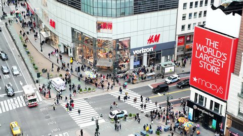 New York City, USA - April 6, 2018: High angle aerial view of Macy's, Verizon and H&M stores at intersection of NYC Herald Square midtown with people crossing crosswalk, traffic cars