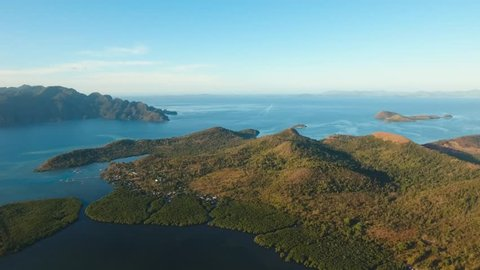 aerial seascape bay with islands and mountains covered with tropical vegetation in the morning time sea bay and lagoon Busuanga, Palawan, Philippines